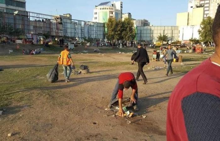 """فلسطين   انصار """"التيار الاصلاحي"""" ينظفون ساحة سرايا غزة بعد مهرجان عرفات"""