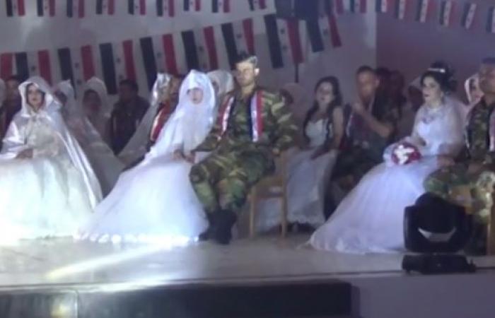 سوريا   بالفيديو .. عرس جماعي لعدد من عناصر ميليشيات بشار الأسد في درعا