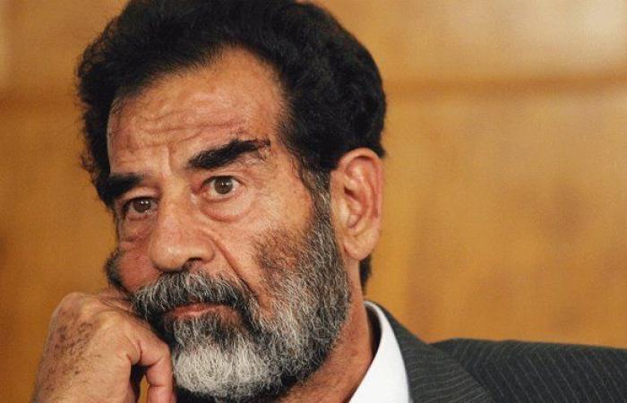 رفع صورة لصدام حسين في تعلبايا